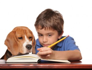 child and dog learn